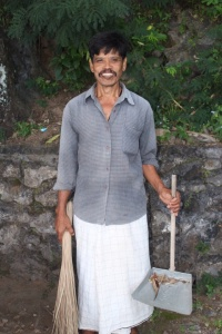 A lovely man I chatted with at length. He was sweeping up around the local temple.