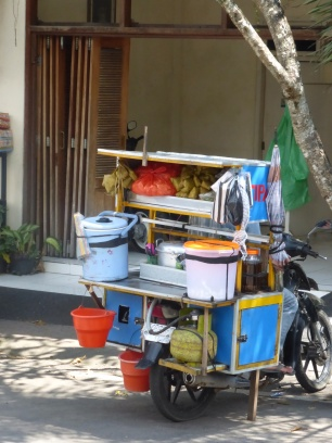 """Meals on Wheels"" Everything on the back of a moped."