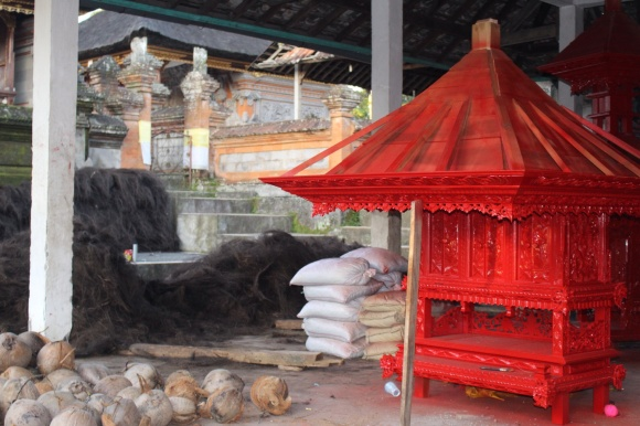 A recently-built temple top awaiting the thatching hand shredded and made from the inside of a palm tree. Labor intensive. They last 30 years.
